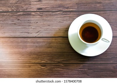 Tea or coffee in a white cup