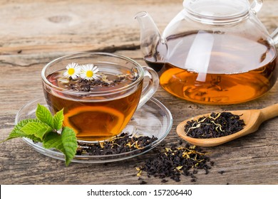 Tea composition with mint leaf on wooden palette