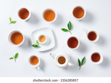 Tea concept,Teapot and cup of herbal tea with green tea leaves,top view