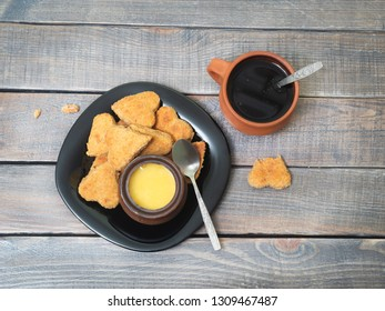Tea and cookies with honey on a wooden table