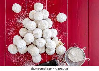 Tea cookies rolled in powdered sugar, also known as Russian tea cakes and Mexican wedding cake cookies arranged in shape of a Christmas tree