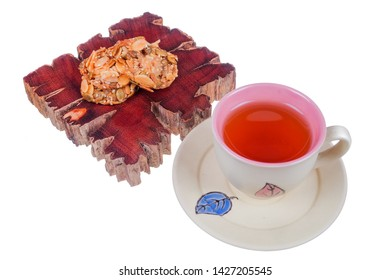 Tea cup and florentine cookies  on white background
