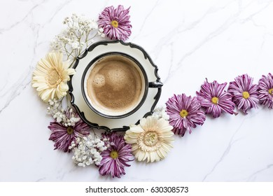 Tea cup with flowers decoration, top view