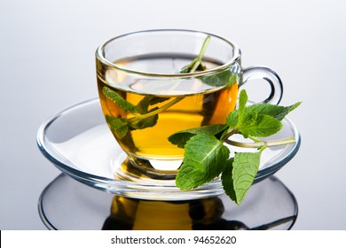 Tea cup with fresh mint leaves, closeup photo