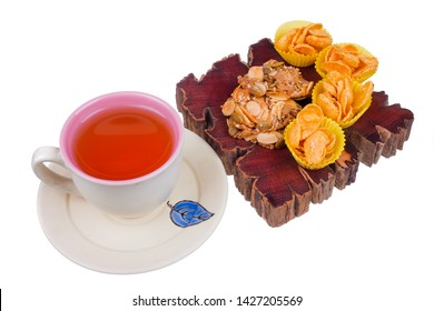 Tea cup , honey corn flake and florentine cookies  on white background