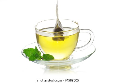 tea in cup with leaf mint  isolated on white background