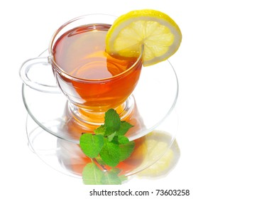 tea in cup with leaf mint and lemon isolated on white