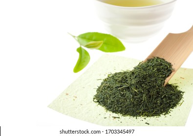 Tea with cup on a light background on a white background. Fresh tea leaves.