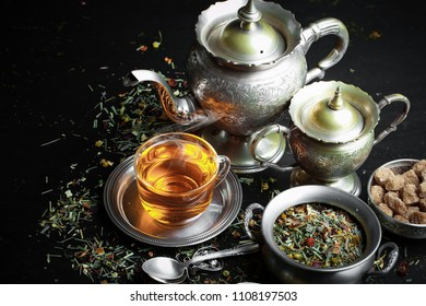 Tea in a cup on an old background