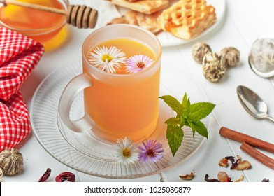 Tea in a cup on a white background with flowers