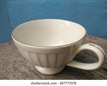 Tea cup on wooden floor