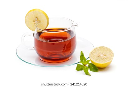 Tea cup and saucer with lemon slice and mint leaf isolated on white background