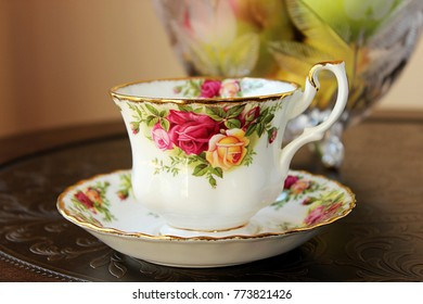 Tea cup and saucer set on a beautiful table.