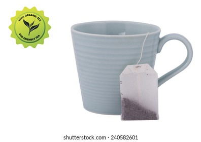 Tea cup, tagged tea bag with an eco friendly label isolated on white background. 100% organic, eco friendly.