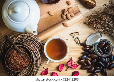 Tea cup and teapot  decoration with baker, darker nut, hay, rope and tea leaves. Morning relaxation concept.