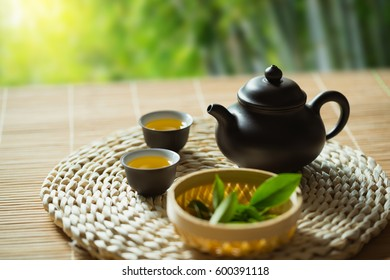 tea cup and teapot on straw mattress