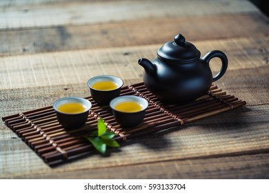 tea cup and teapot on wood plank