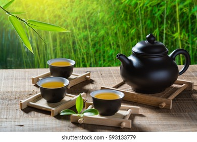 tea cup and teapot on wood plank outside the door