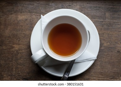 Tea cup and tea from upside on wood table