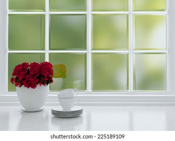 Tea cups and roses on the marble worktop in front of big window. White kitchen design.