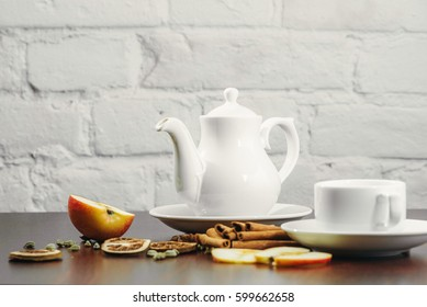 Tea cups with teapot on old wooden table. Fruit ginger hot drink. White background.