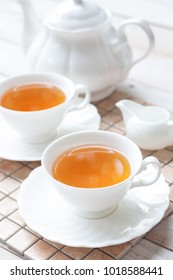 Tea in cups with teapot, teatime concepts