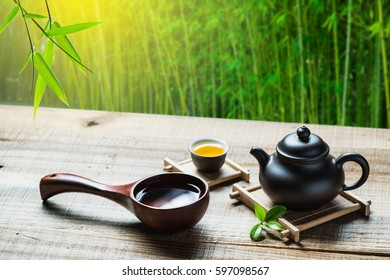 tea cup,teapot and good water on wood plank outside the door