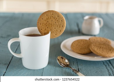 Tea with digestive dunking biscuit