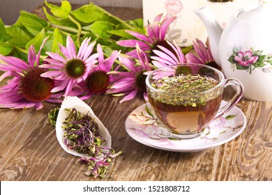 Tea drink with Echinacea purpurea (Echinacea purpurea) dried on a wooden table texture