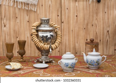 Tea drinking. Samovar, bagels, tea set and pancake on a saucer