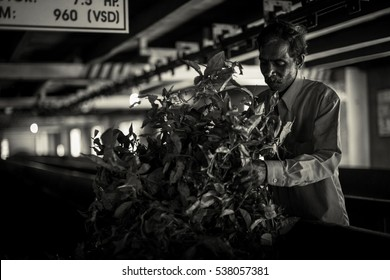 Tea factory. Worker at tea factory drying tea in Sri Lanka. Black and white photo. Selective focus.