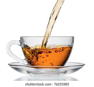 Tea flowing in cup