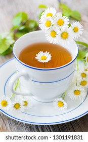 Tea of fresh daisies and birch leaves