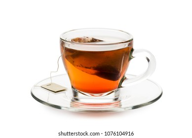 tea in glass cup with tea bag inside, on white background