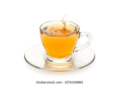 tea in glass cup with drop splashing, on white background