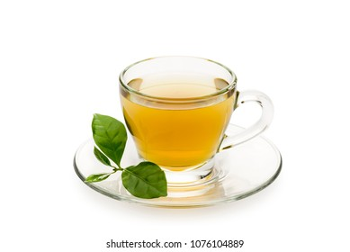 tea in glass cup with leaves, on white background