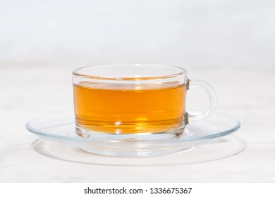 tea in a glass cup on a white background, horizontal
