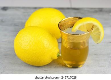 tea glass of lemon tea, on grey old wooden table
