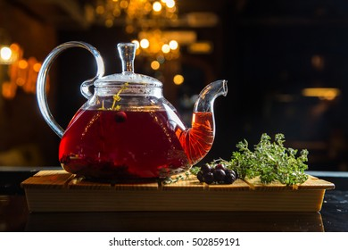 tea in glass teapot on a wooden table