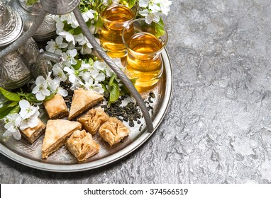 Tea glasses and pot, traditional sweets. Islamic holidays decoration