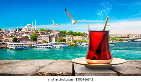 Tea in Golden Horn bay of Istanbul and view on Suleymaniye mosque, Turkey