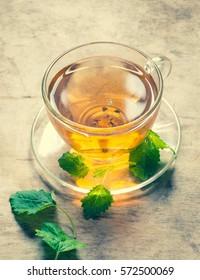 Tea with green melissa/toned photo