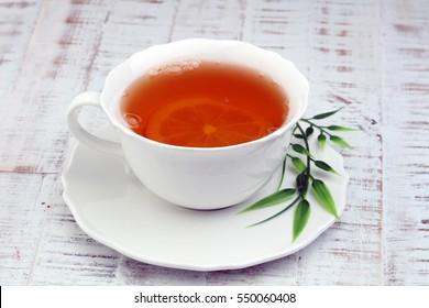 Tea. Herbal tea. Mint leaf. Tea in a glass cup, mint leaves, dried tea, sliced lime. herbs on a slate plate in a restaurant or teahouse