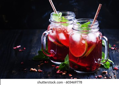 Tea with hibiscus, fruit, mint and ice, selective focus