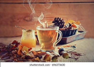 Tea with honey and spices, concept of autumn postcard, effect of a couple