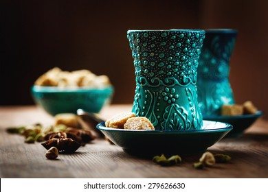 Tea or Hot Wine with Various Spices in Traditional Turkish Glasses on Wooden Background. Selective Focus. Surface View.