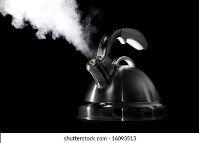 Tea kettle with boiling water.
