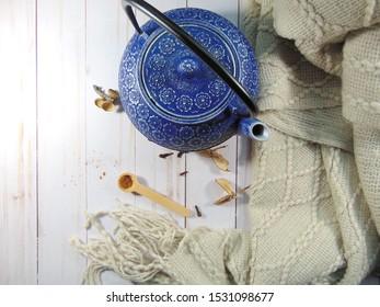 Tea kettle with spices. Cinnamon and cloves tea time.