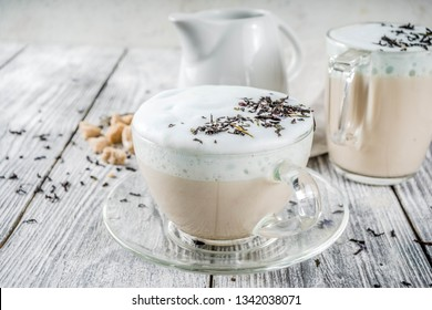 Tea latte, Earl Grey Hot London Fog Tea Drink with Foamed Milk, wooden background copy space