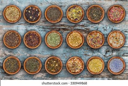 Tea leaves collection on decrepit blue wood background